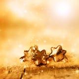 Fundo para o Natal com estrelas douradas Imagem de Stock