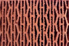 Fundo perfurado vermelho do tijolo imagem de stock