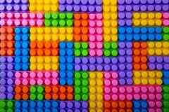 Fundo plástico dos blocos de apartamentos do brinquedo foto de stock
