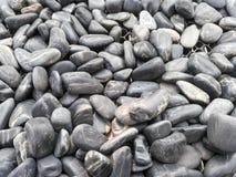 Fundo preto áspero da textura à terra da rocha Imagens de Stock Royalty Free