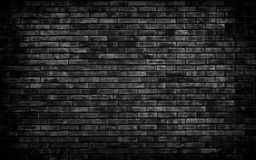 Fundo preto da parede de tijolo fotografia de stock