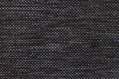 Fundo preto de matéria têxtil com teste padrão quadriculado, close up Estrutura do macro da tela Imagens de Stock