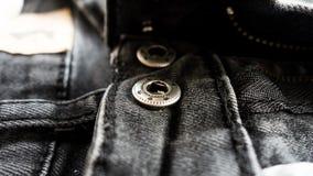 Fundo preto do sumário da textura das calças de brim: tom preto e branco Foto de Stock Royalty Free