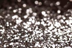 Fundo preto e de prata do brilho da faísca O feriado, o Natal, os Valentim, a beleza e os pregos abstraem a textura Imagens de Stock Royalty Free