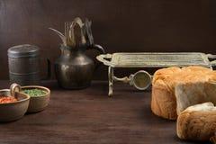 Fundo rústico velho do alimento com pão e molho Imagem de Stock Royalty Free