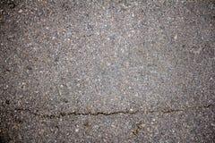 Fundo rachado da textura da estrada fotografia de stock