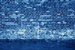 Fundo resistido da parede de tijolo no tom dos azuis marinhos Foto de Stock