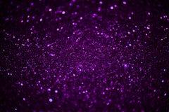 Fundo roxo escuro do brilho do chuveirinho Imagem de Stock Royalty Free