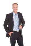 Fundo seguro de Standing Over White do homem de negócios Fotos de Stock