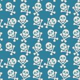 Fundo sem emenda azul Crânio e ossos piratas Fotografia de Stock