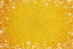 Fundo simples de Glittle do ouro com uma beira da luz branca imagem de stock