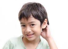 Fundo tímido do branco do portraiton da cara do rapaz pequeno Fotografia de Stock