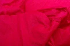 Fundo/textura vermelhos do Natal do papel de crepe Fotos de Stock