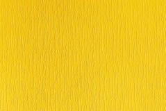 Fundo textured amarelo com as listras verticais pequenas foto de stock
