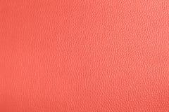 Fundo textured de couro na cor coral de vida imagem de stock
