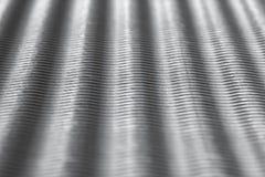 Fundo Textured de papel de prata - listras da onda imagens de stock royalty free