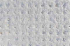 Fundo uma superfície da neve do não-uniforme imagens de stock