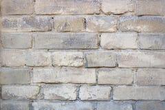 Fundo velho amarelo da parede de tijolo Imagem de Stock