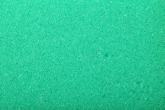 Fundo verde da esponja da espuma da celulose da textura imagem de stock royalty free