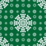 Fundo verde sem emenda dos flocos de neve do Natal Foto de Stock