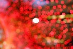 Fundo vermelho borrado do bokeh Fotografia de Stock Royalty Free