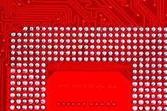 Fundo vermelho da textura da placa de circuito do cartão-matriz do computador Imagem de Stock