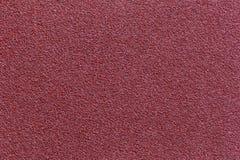 Fundo vermelho da textura da lixa para o projeto de conceito industrial da construção imagens de stock royalty free
