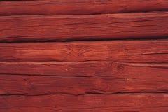 Fundo vermelho de madeira da parede do log, tradicional em Escandinávia imagens de stock