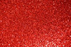 Fundo vermelho do glitter O feriado, o Natal, os Valentim, a beleza e os pregos abstraem a textura fotos de stock royalty free
