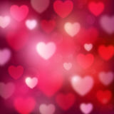Fundo vermelho romântico abstrato com corações e luzes do bokeh Fotografia de Stock Royalty Free