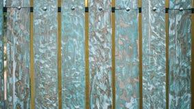 Fundos e conceito da textura - cerca de madeira velha pintada no fundo azul Imagem de Stock Royalty Free