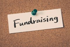 Fundraising. Concept word on a cork board Royalty Free Stock Photo