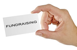 Fundraising. Hand with card for Fundraising Stock Photos