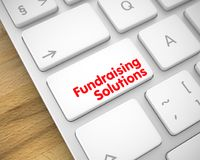 Fundraising Solutions on the White Keyboard Keypad. 3D. Close Up White Keyboard Key - Fundraising Solutions. Business Concept: Fundraising Solutions on the Royalty Free Stock Image