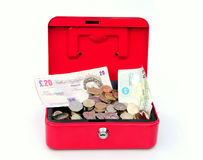Funds. Shot of a healthy cash box full of copins and notes Royalty Free Stock Image