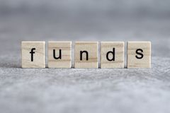 Funds word written on wood cube royalty free stock photo