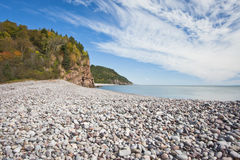 Fundy Trail. Stony beach on the Fundy Trail in New Brunswick under a blue sky Royalty Free Stock Photography