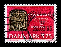 Funen Guldgubber, art-objects, amulets, or offerings, Archeological findings - Danish Treasure Trove serie, circa 1993. MOSCOW, RUSSIA - OCTOBER 3, 2017: A stamp Stock Images
