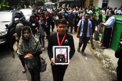 FUNERAL OF AIRASIA FLIGHT CRASH VICTIM. The funeral procession of Air Steward Oscar Desano, which dies on AirAsia flight 8501 crash last December. The Indonesian Stock Image