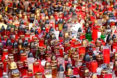 Funeral candles at day. Closeup on hundreds of various funeral candles at daylight Royalty Free Stock Image