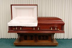 Funeral Casket. Wooden casket made of Cherry in a funeral home Stock Photo