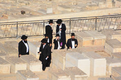 Funeral ceremony. JERUSALEM ISRAEL 23 10 16: Funeral ceremony near graves of the ancestors in the jewish cemetery on Mount of Olives in Jerusalem, Israel royalty free stock photography