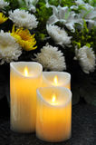 Funeral Flowers and Candles. Chinese Funeral flowers for condolences,white and yellow chrysanthemum,white lily royalty free stock image