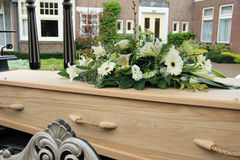 Funeral flowers on a casket. Funeral service royalty free stock photo