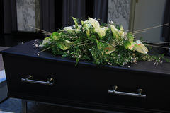 Funeral flowers on a casket. Funeral service royalty free stock photography