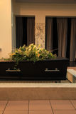 Funeral flowers on a casket Stock Images