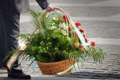 Funeral flowers. Green plants and flowers in funeral basket Royalty Free Stock Photo