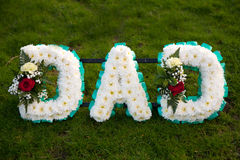 Funeral flowers tribute dad. Funeral flowers in tribute to dad stock photography