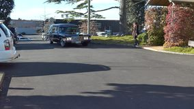 Funeral hearse arriving chapel stock video