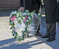 Funeral heart doves. Photo of doves in a heart shaped cage at a funeral service stock photos